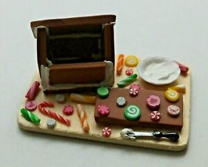 Dollhouse Miniatures: handcrafted gingerbread house in the making