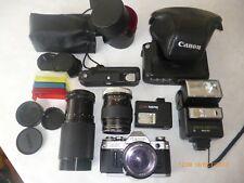 Canon AE-1, 70-210 lens, 135 lens, 50 lens, flash, motor drive