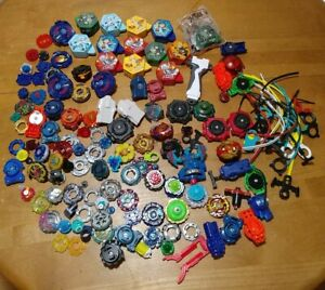BeyBlades Huge Mixed Lot Of Tops Launchers  Ripcords