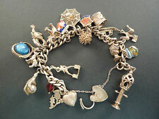 SILVER CHARM BRACELET WITH 18 CHARMS, including a lobster and a spider