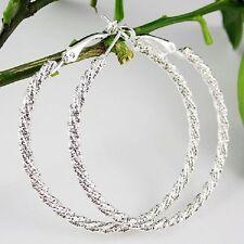modische Ohrringe Kreolen Creolen gedreht 5 cm Durchmesser Loops
