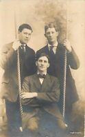 C-1910 Three men on swing RPPC Real photo postcard 2560