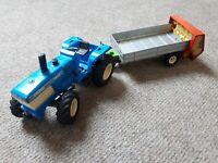 Siku Spielzeug Traktor Trecker Blau 2344 Ford TW-35 Anhänger 2701