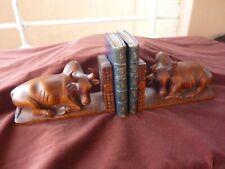 paire serre livres aux buffles,indochine,bois,600g pièce,L 22cm