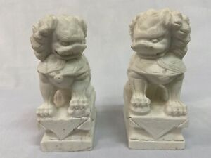 Two Chinese carved white marble foo lion book ends. H 7.25 W 3 Depth 3.75