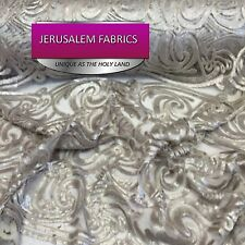 Sequins paysley design fabric mesh lace beige. Sold by the yard.
