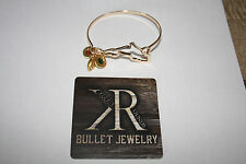 Florida jewelry. Yellow Metal Bangle Bracelet Green Orange Colors Bullet casings
