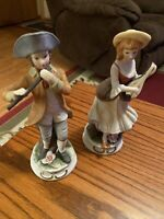 Vintage Colonial Man Playing Flute and Woman Playing Banjo Bisque Figurines