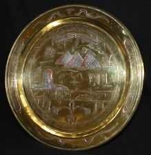 A antique Egyptian brass charger inlaid with copper and silver  circa 1915/20.