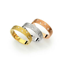Yellow 14k gold textured grooved gold artisan wedding band with diamonds