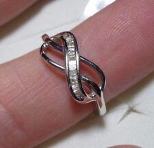 Diamond Infinity Ring Sz. 7  23 diamonds .25tcw MSRP$589.00