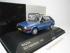 MAZDA 323 HATCHBACK 1982 1/43 WHITEBOX (BLUE)