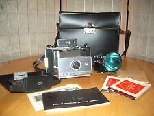 Vintage Polaroid Land Camera Automatic 100 with flash attachment