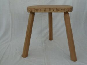Oak 3 leg stool with acorn motif. Craftsman made with optional inscription.