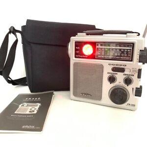 Eton FR300 AM/FM Radio NOAA TV VHF Flashlight Cellphone Charger With Case Manual