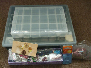Storage boxes with compartments and a selection of beads/ sequins etc.