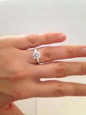 the Side .925 Sterling Silver Closeout Cz Ring 2.00ct Round with Baguettes on