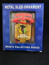 CHICAGO BLACKHAWKS METAL SLED CHRISTMAS ORNAMENT WITH ICONIC TEAM LOGO ON SEAT
