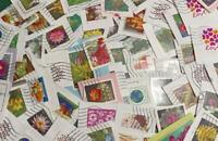 200 Different Forever Stamps Used on Paper