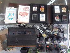 Atari 2600 with 8 games, manuals, paddles untested