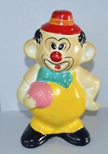 Old Ceramic Money Box In The Form Of A Circus Clown holding A Ball.