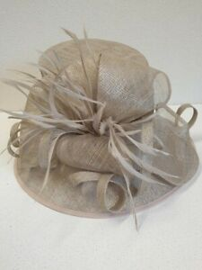 Linea, mother of the bride hat in a sheeny mink mesh.