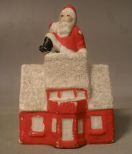 Snow Baby Figure of Santa on a Roof