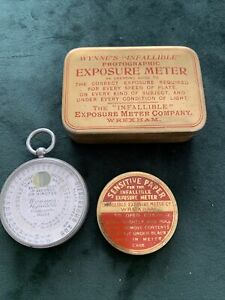 Wynne's Infallible Photographic Exposure Meter tin and papers