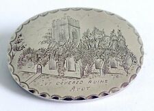A VICTORIAN UNMARKED SILVER BROOCH OF IVY COVERED RUINS AVOT WITH LOCKET BACK