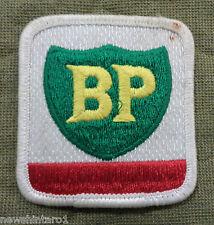 #D134.  BP PETROLEUM  CLOTH PATCH  & TIN BADGE