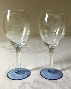 TWO, A PAIR OF VINTAGE HAND BLOWN GLASS WINE GLASSES. ETCHED, BLUE BASES