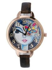 Montre bracelet motif visage de femme et papillon, a quartz.