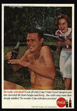 1960 COCA-COLA - Pretty Woman Spraying Man With A Garden Hose - VINTAGE AD