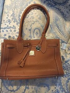Authentic Dooney and Bourke brown leather saddle bag gorgeous