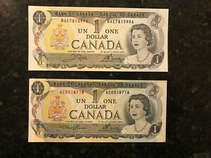 2 UNCIRCULATED 1973 CANADIAN ONE DOLLAR BILLS