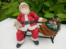 CCLOTHTIQUE SANTAS BY POSSIBLE DREAMS SANTA SITTING ON PARK BENCH w/ HIS TOY BAG