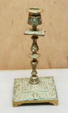 Ancien bougeoir en bronze a decor de fleurs de lys et tete