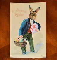 1906 Easter Postcard Dressed Bunny Rabbit Carrying Pink Egg & Basket Germany