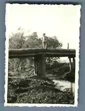 China, Soldier posing on a bridge  Vintage silver print. Vintage China. 中国葡萄酒