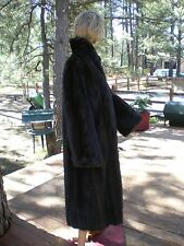 Dark brown,medium length, female ranch mink coat in excellent condition.