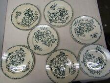serie de 7 assiettes en terre de fer datura