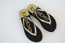 4ef1cf7d137614 Bebe Womens Black Gold Crystal Rhinestone Logo Wedge Flip Flops Sandals Sz 7