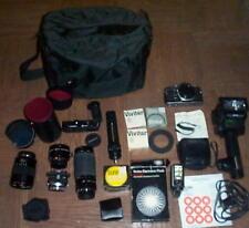 Olympus OM-1 35mm SLR Film Camera bundle with 50 mm lens,Macro,Zoom and more!