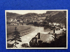 Sepia postcard: Monmouthshire, Tintern - river, bridge and abbey posted 1935