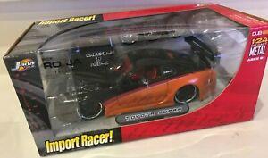 JADA TOYS Import Racer! Toyota Supra Dub City 1:24 Diecast w/ Ro-Ja Wheels 53705