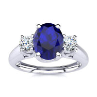 14K GOLD,1 1/5 CARAT OVAL SHAPE SAPPHIRE AND TWO DIAMOND RING - In 3 Gold Colors
