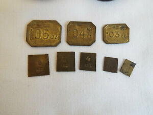 7 antique brass apothecary weights with excise marks.