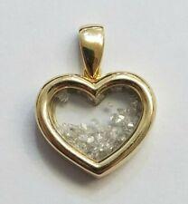 10 KARAT YELLOW GOLD HEART PENDANT WITH 0.50 CARAT FLOATING DIAMONDS