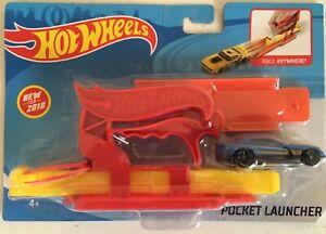 New in plastic Hot Wheels Pocket Launcher - Blue car.