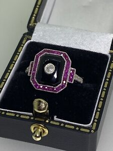 An Art-Deco Style Onyx, Diamond, Ruby Octagon Shaped Ring in Gold & Silver